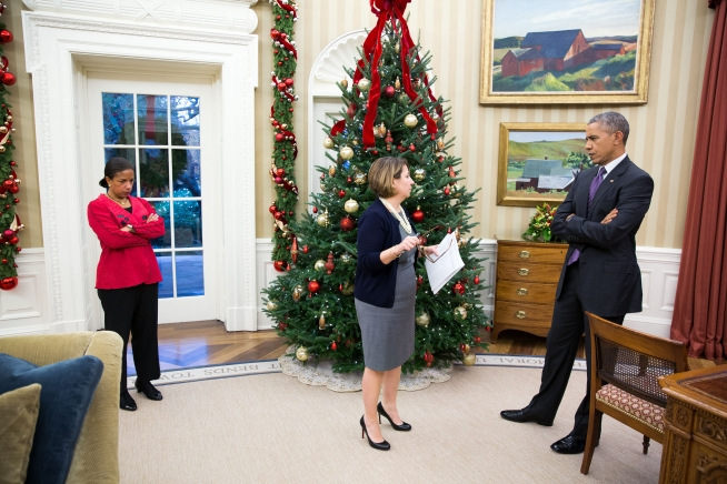 President Barack Obama receives an update on the mass shootings in San Bernardino, Calif., from Lisa Monaco, Assistant to the President for Homeland Security and Counterterrorism, as National Security Advisor Susan E. Rice listens, in the Oval Office, Dec. 2, 2015